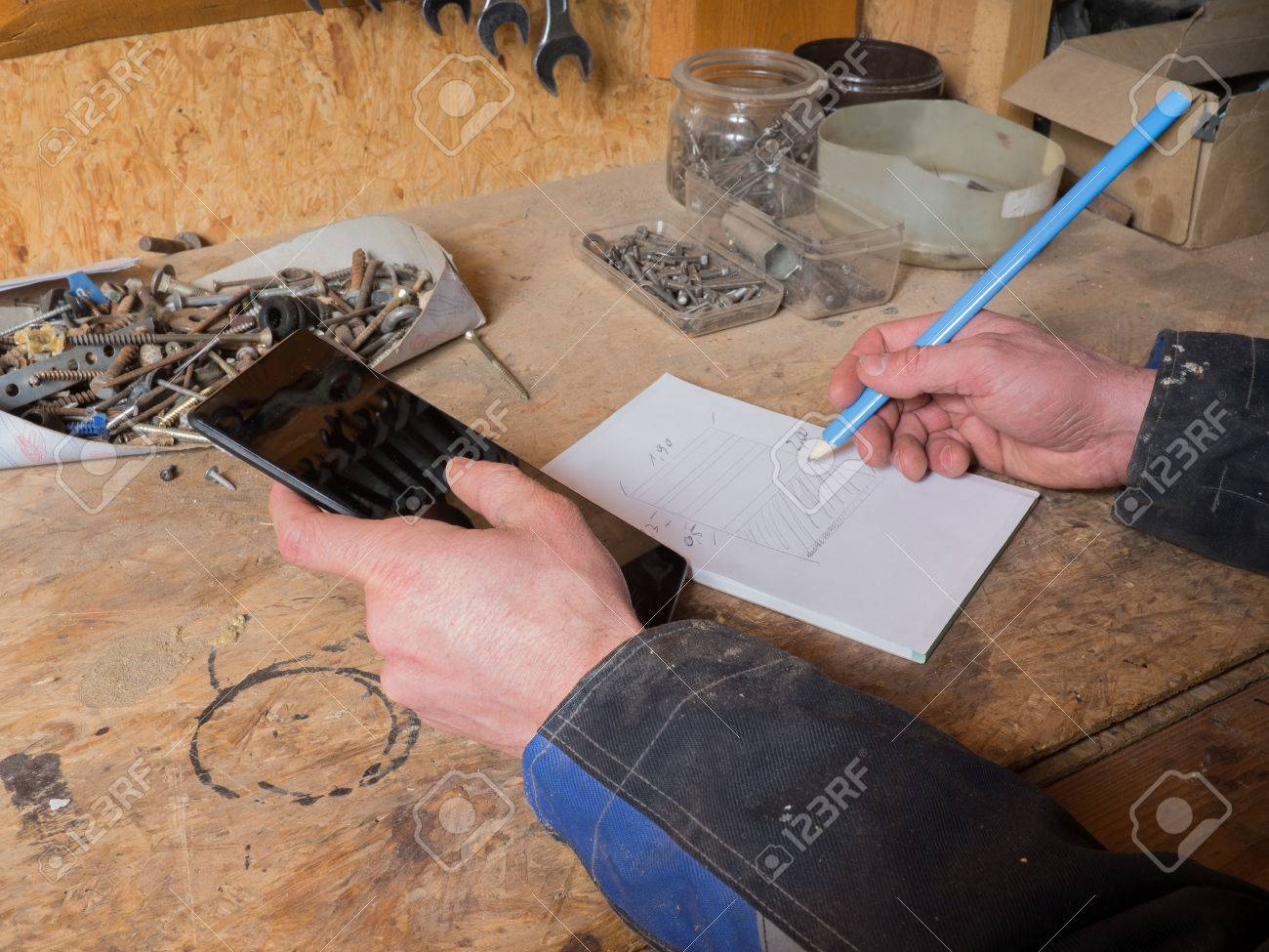 Carpenter with digital tablet and blueprint at workbench stock photo carpenter with digital tablet and blueprint at workbench stock photo 59871316 malvernweather Images