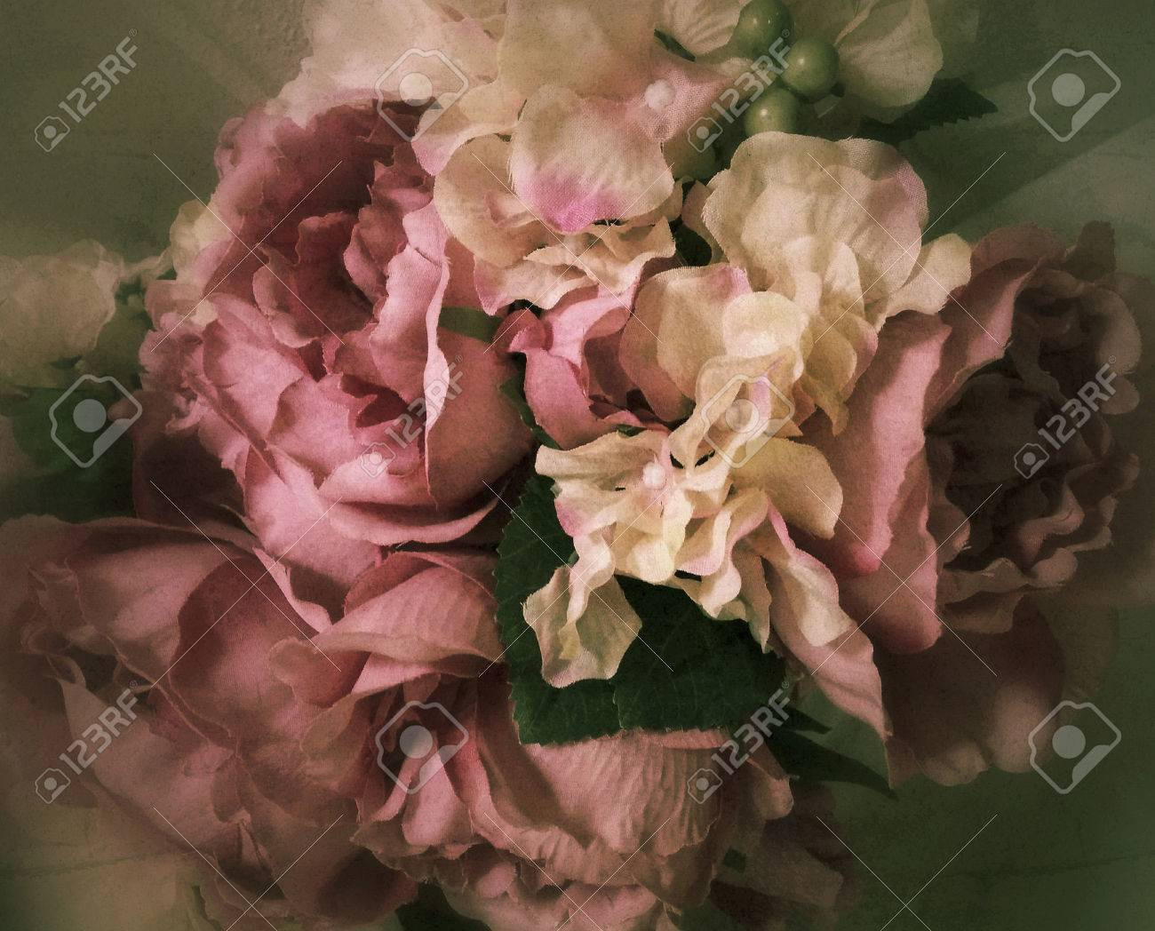 Vintage bouquet of fabric roses background stylized flowers and stockfoto vintage bouquet of fabric roses background stylized flowers and filtered to seem an old victorian still life painting izmirmasajfo
