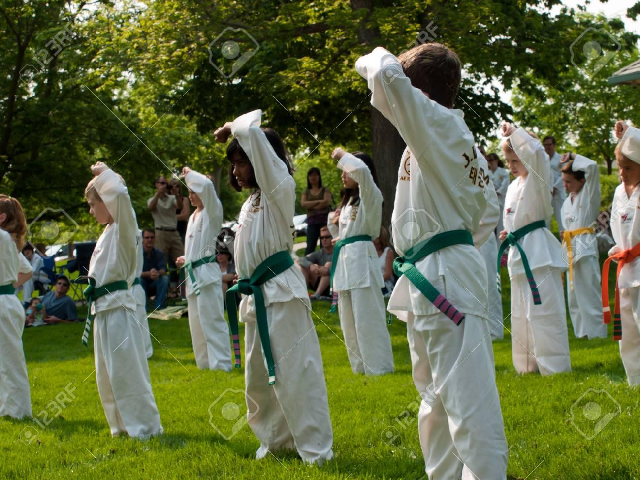 Belt test at J.W. Kim TaeKwonDo School. At the park in Greenwood Village, Colorado. June 2011. Stock Photo - 9671572