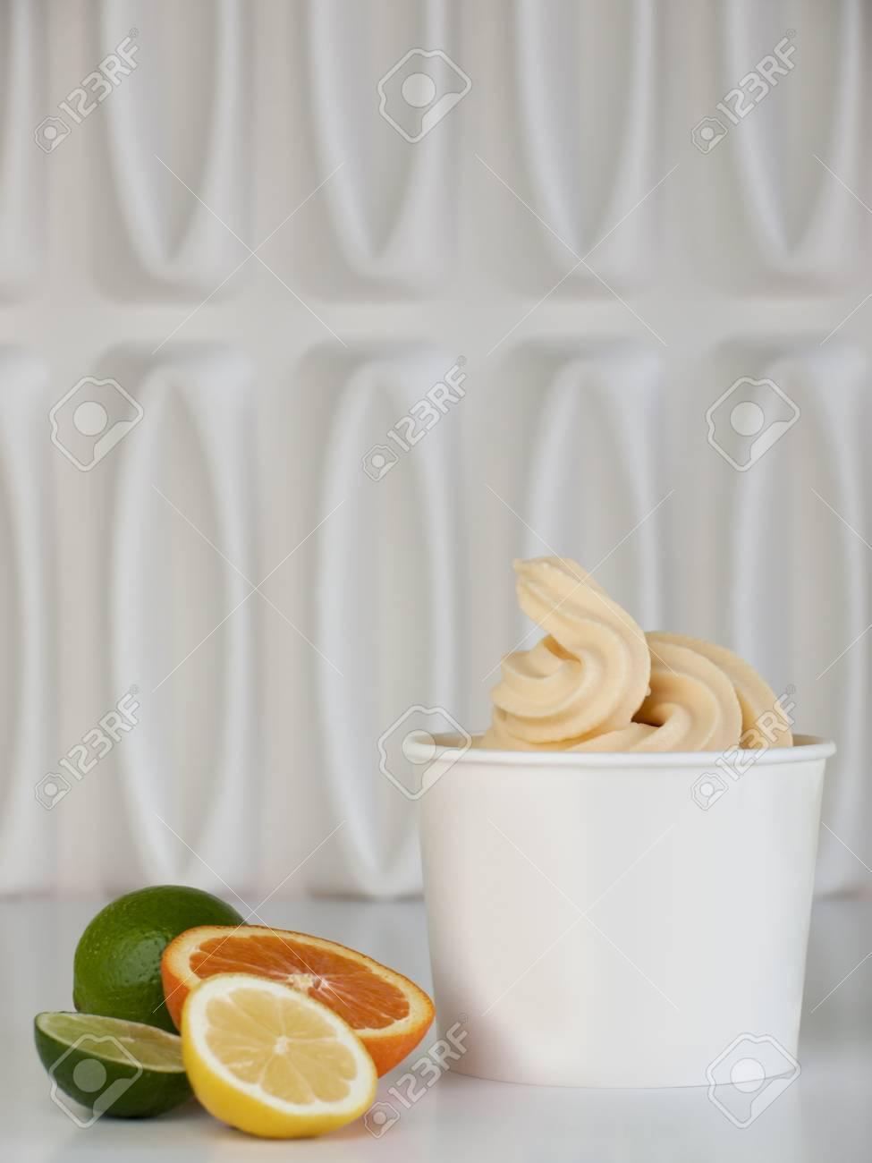 Cup of tropical frozen yogurt with fresh fruit. Stock Photo - 13081035