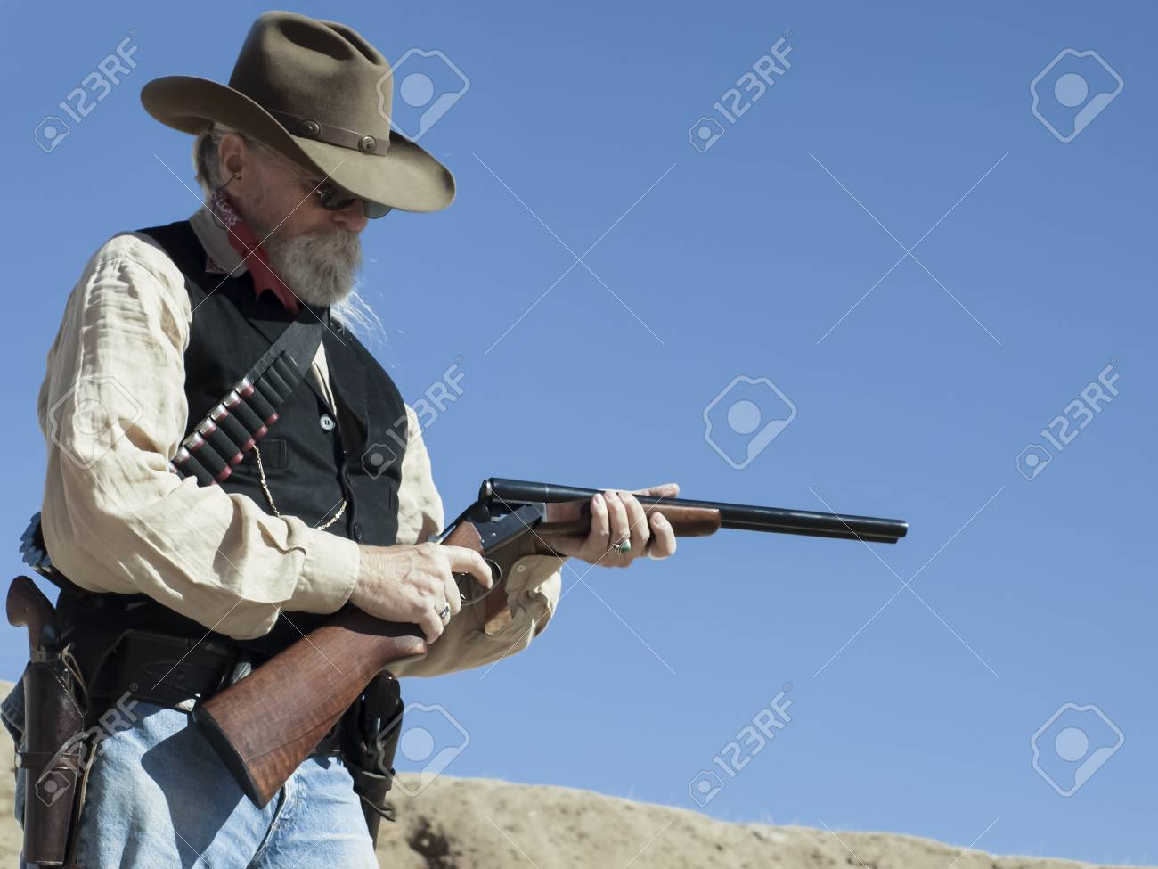 Cowboy Action Shooting Club. The firearms used are based on those which existed in the 19th century American West, i.e. lever action rifle, single action revolver, and shotgun. Stock Photo - 13118291