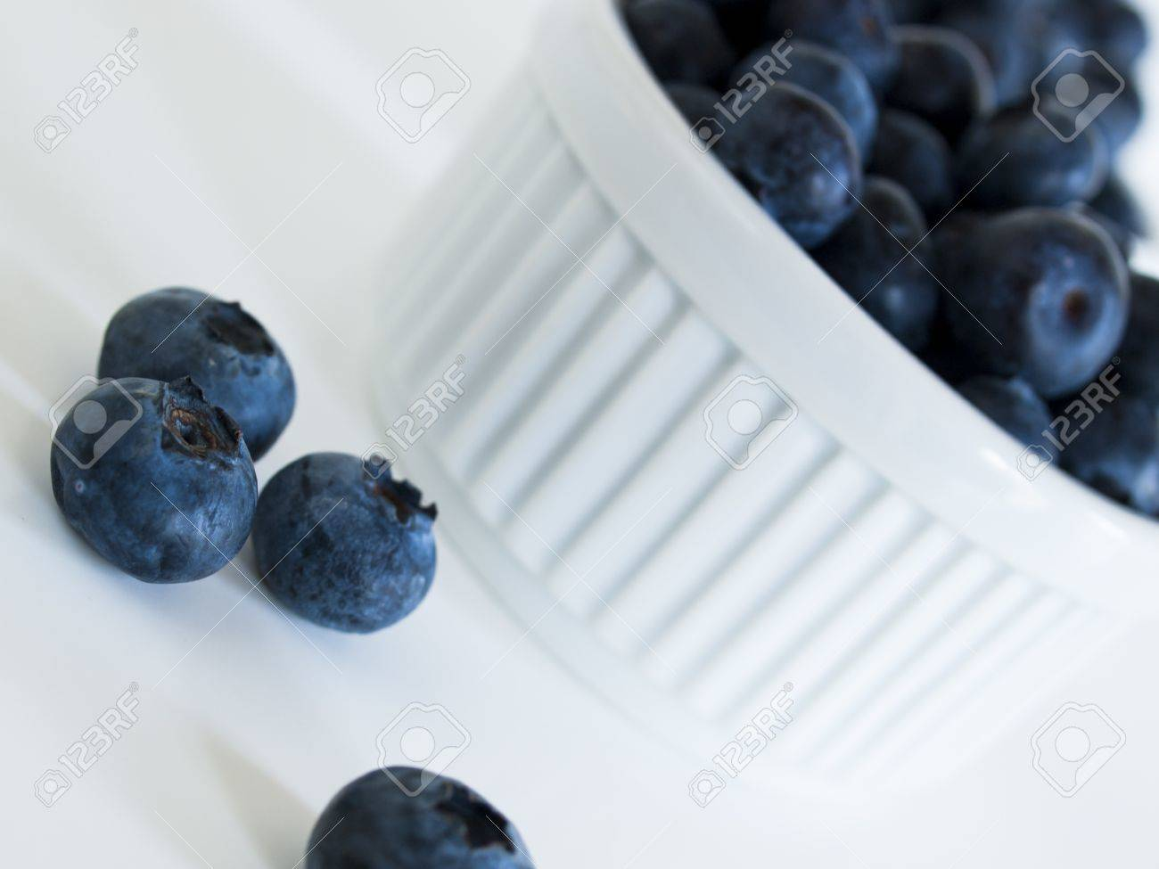 Fresh bluberries from local market on white background. Blueberries contain anthocyanins,  and various phytochemicals, which possibly have a role in reducing risks of some diseases. Stock Photo - 13695119