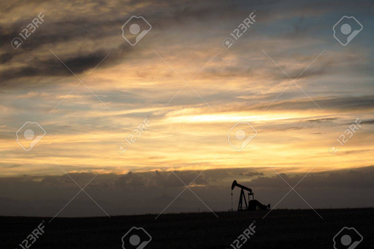 A pumpjack silhoutte with dramatic sunset. Stock Photo - 13999272