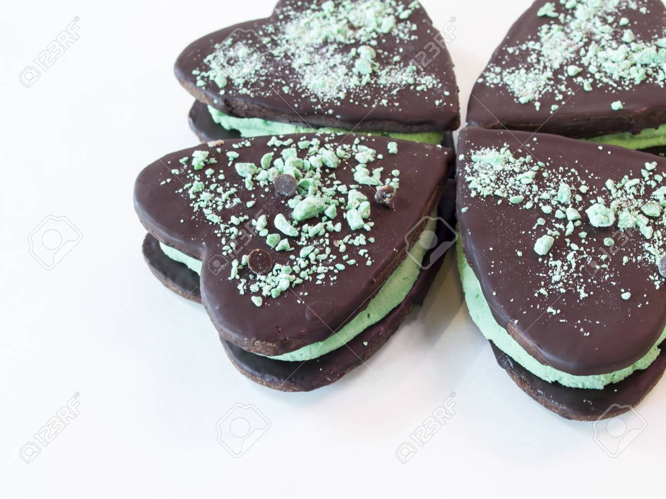 Chocolate cookies with mint filling on white background. Stock Photo - 14047393