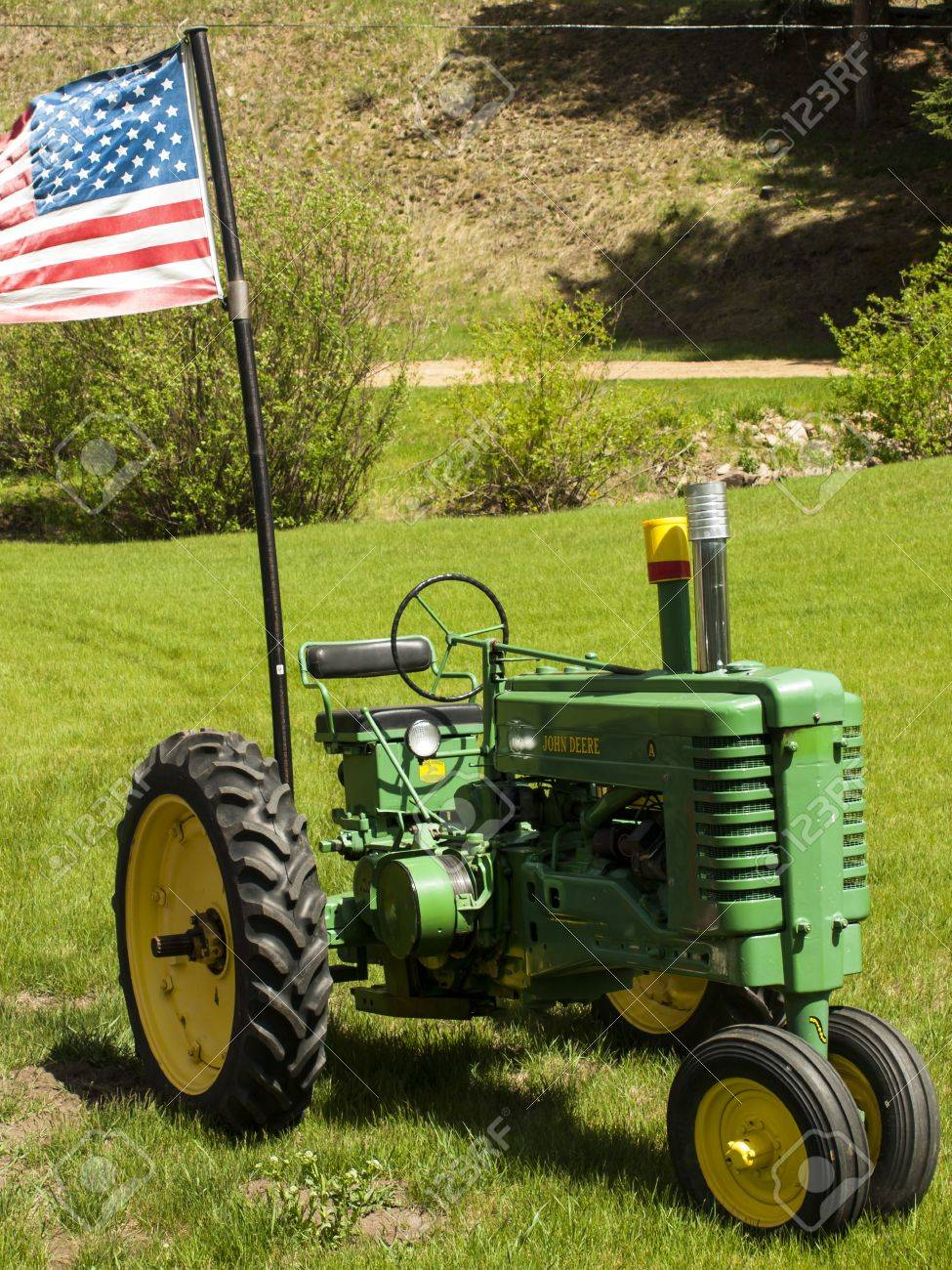 Old Farm Tractor With American Flags. Stock Photo, Picture And Royalty Free  Image. Image 14147680.