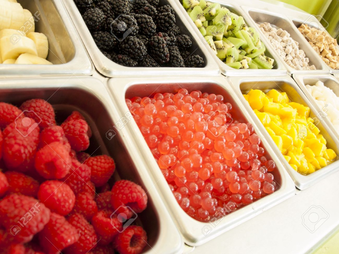 Attrayant Frozen Yogurt Toppings Bar. Yogurt Toppings Ranging From Fresh Fruits,  Nuts, Fresh