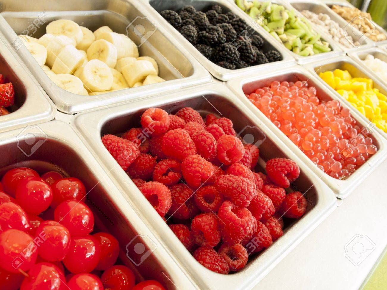 Frozen Yogurt Toppings Bar. Yogurt Toppings Ranging From Fresh Fruits,  Nuts, Fresh