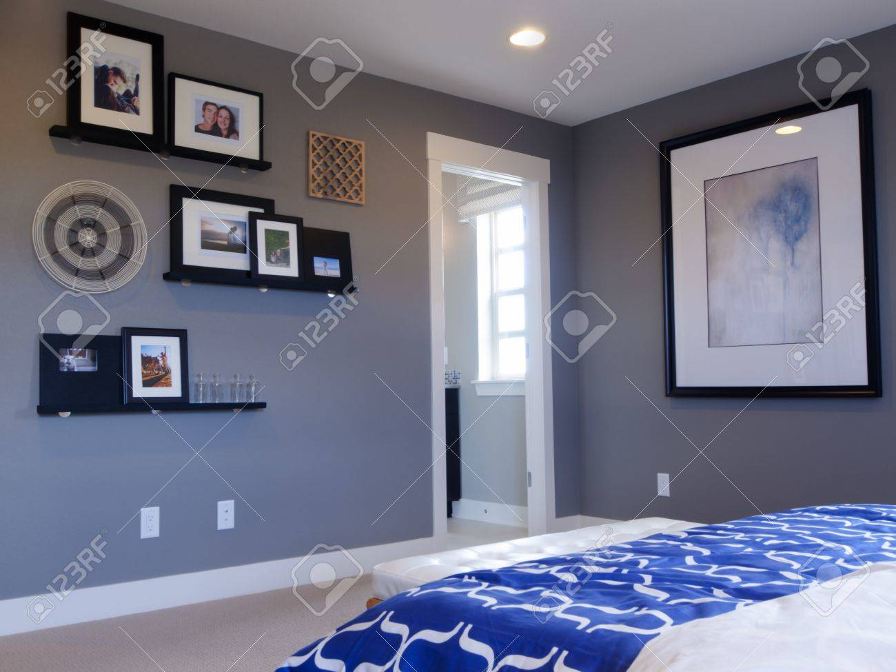 Blue modern master bedroom - Modern Master Bedroom With Blue Wall And White Linens Stock Photo 15079258