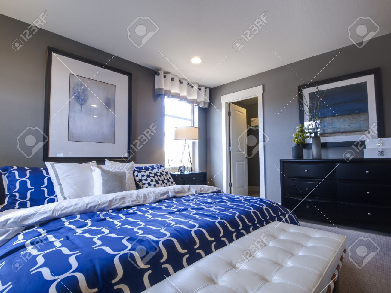 Blue modern master bedroom - Modern Master Bedroom With Blue Wall And White Linens Stock Photo 15079265