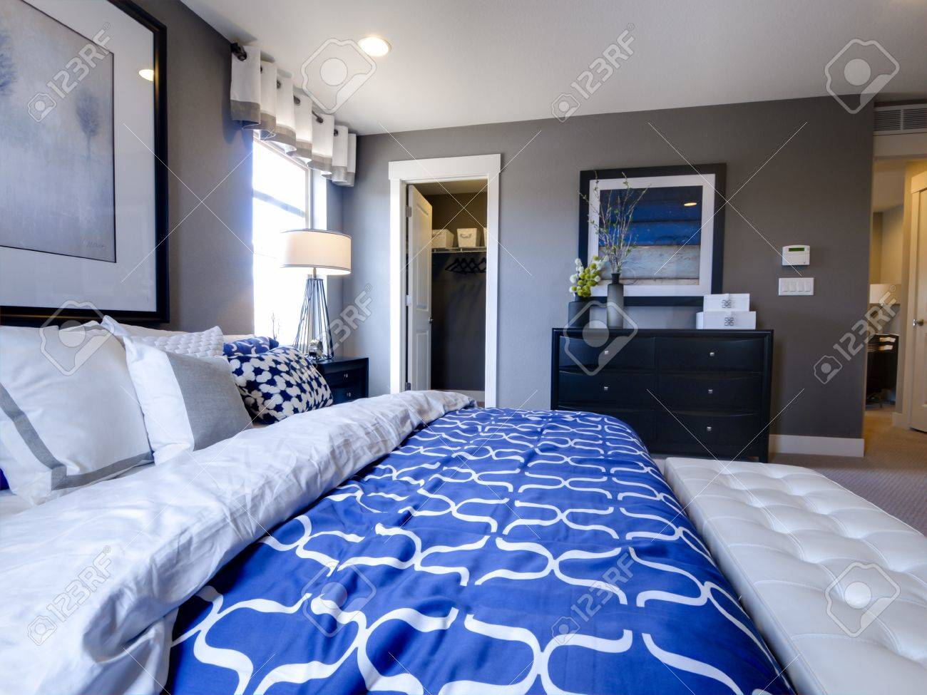 Blue modern master bedroom - Modern Master Bedroom With Blue Wall And White Linens Stock Photo 15079264