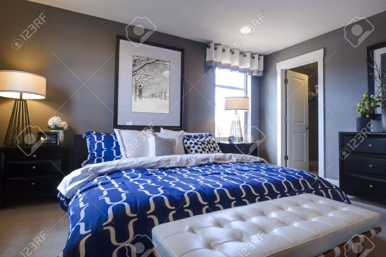 Blue modern master bedroom - Modern Master Bedroom With Blue Wall And White Linens Stock Photo 15079401