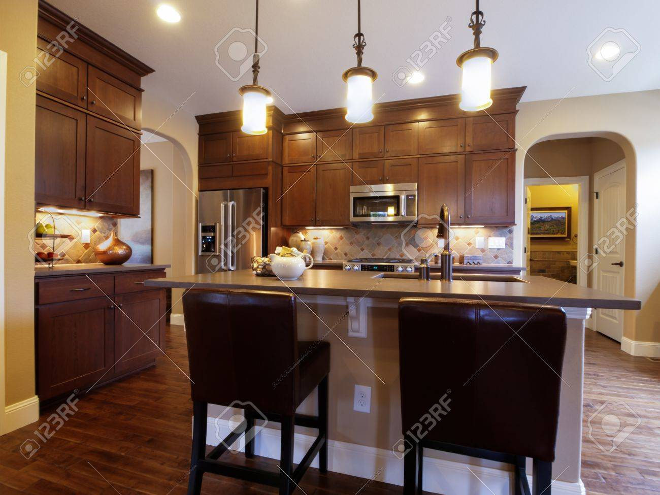 Modern kitchen with wood cabinets and stainless appliances. Stock Photo - 15079358