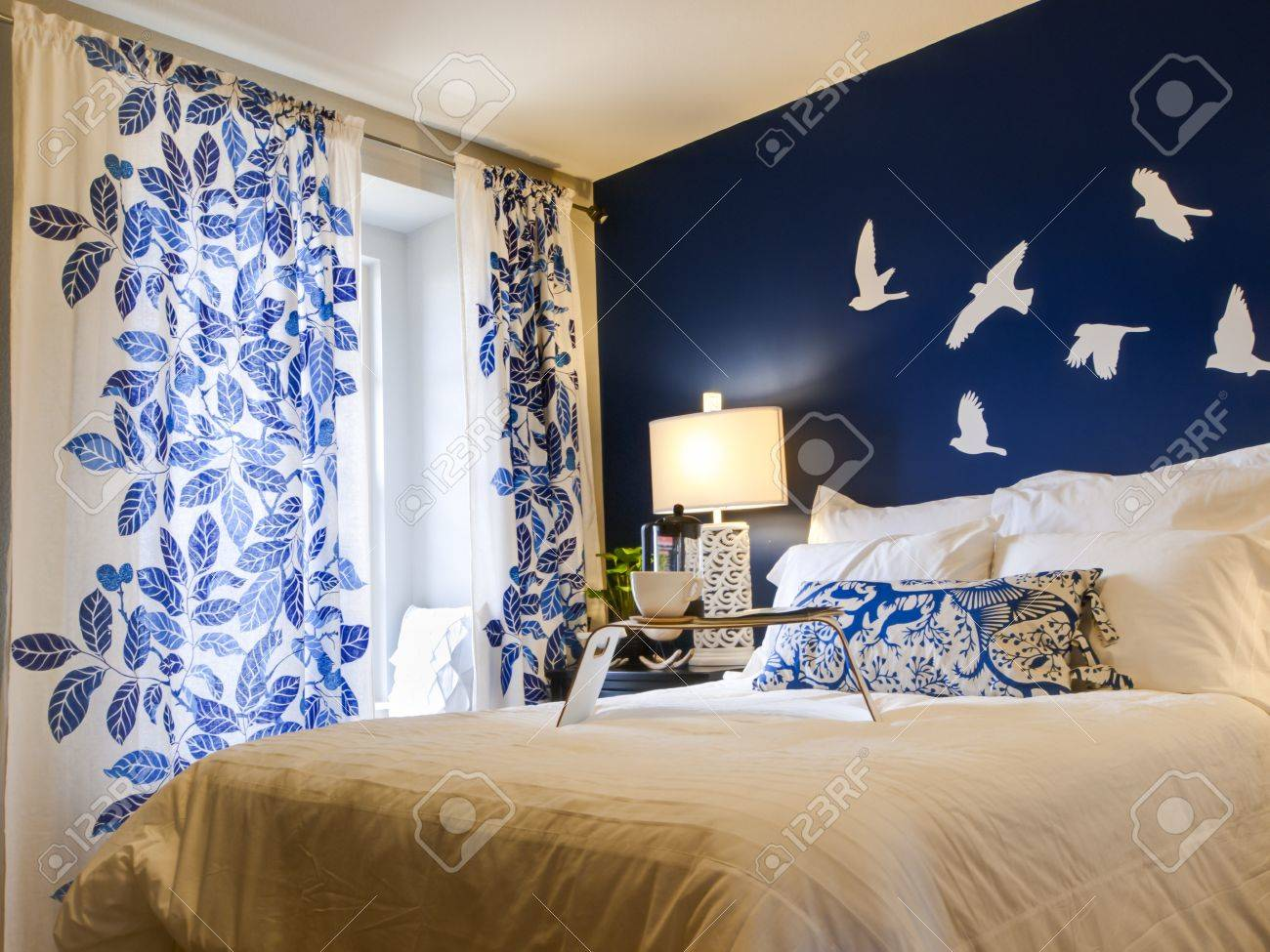 Blue modern master bedroom - Modern Master Bedroom With Blue Wall And White Linens Stock Photo 15079453
