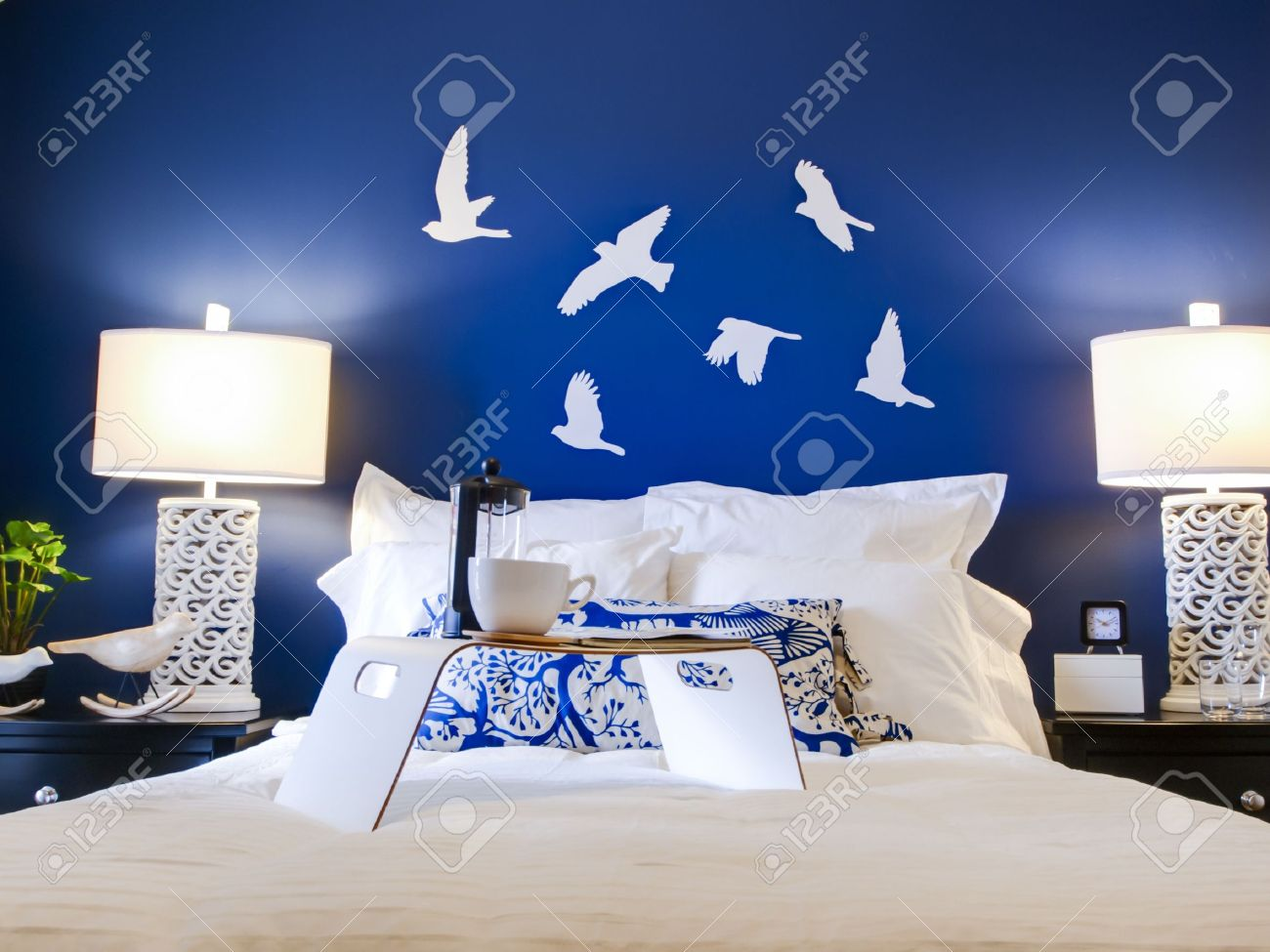Blue modern master bedroom - Modern Master Bedroom With Blue Wall And White Linens Stock Photo 15079362