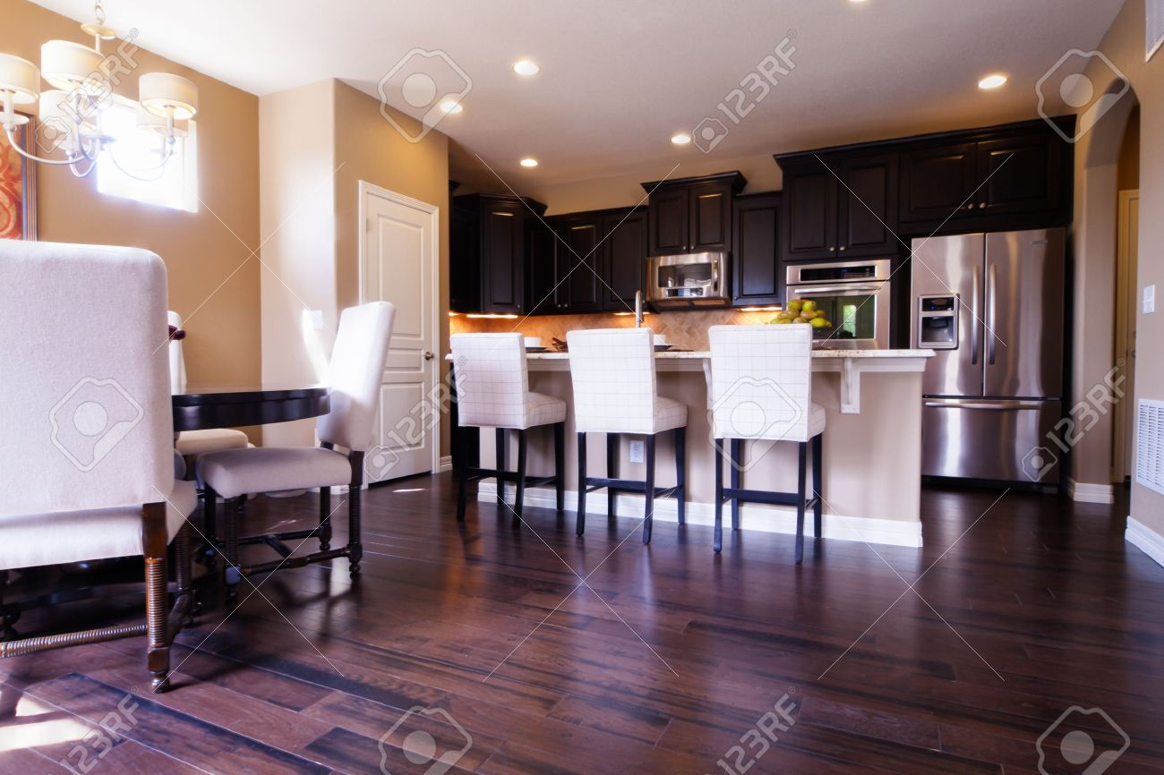 Dark Wood Modern Kitchen modern kitchen with dark wood cabinets and hardwood floors. stock