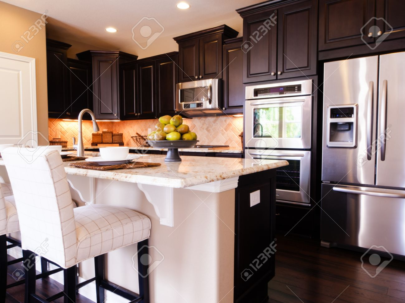 Modern Kitchen With Dark Wood Cabinets And Hardwood Floors. Stock Photo    15079365