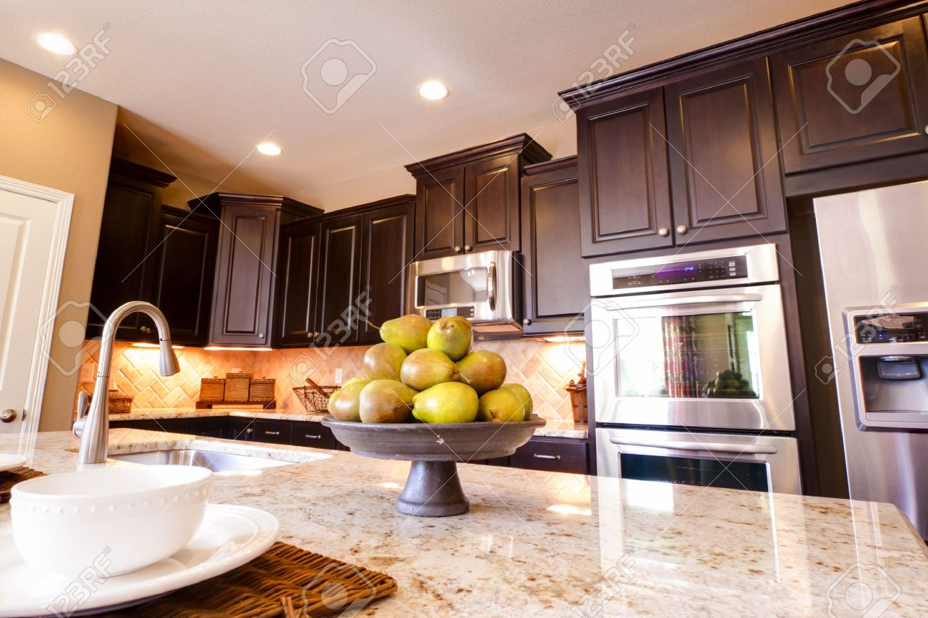 Kitchen Dark Wood Floors Modern Kitchen With Dark Wood Cabinets And Hardwood Floors Stock