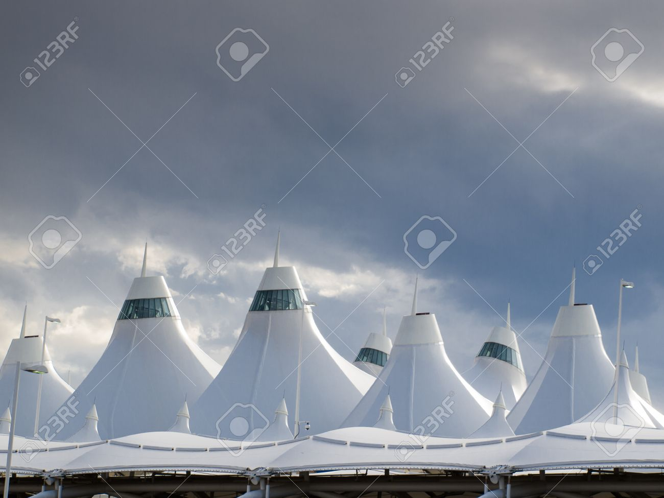Denver International Airport Well Known For Peaked Roof Design Of Roof Is  Reflecting Snow Capped