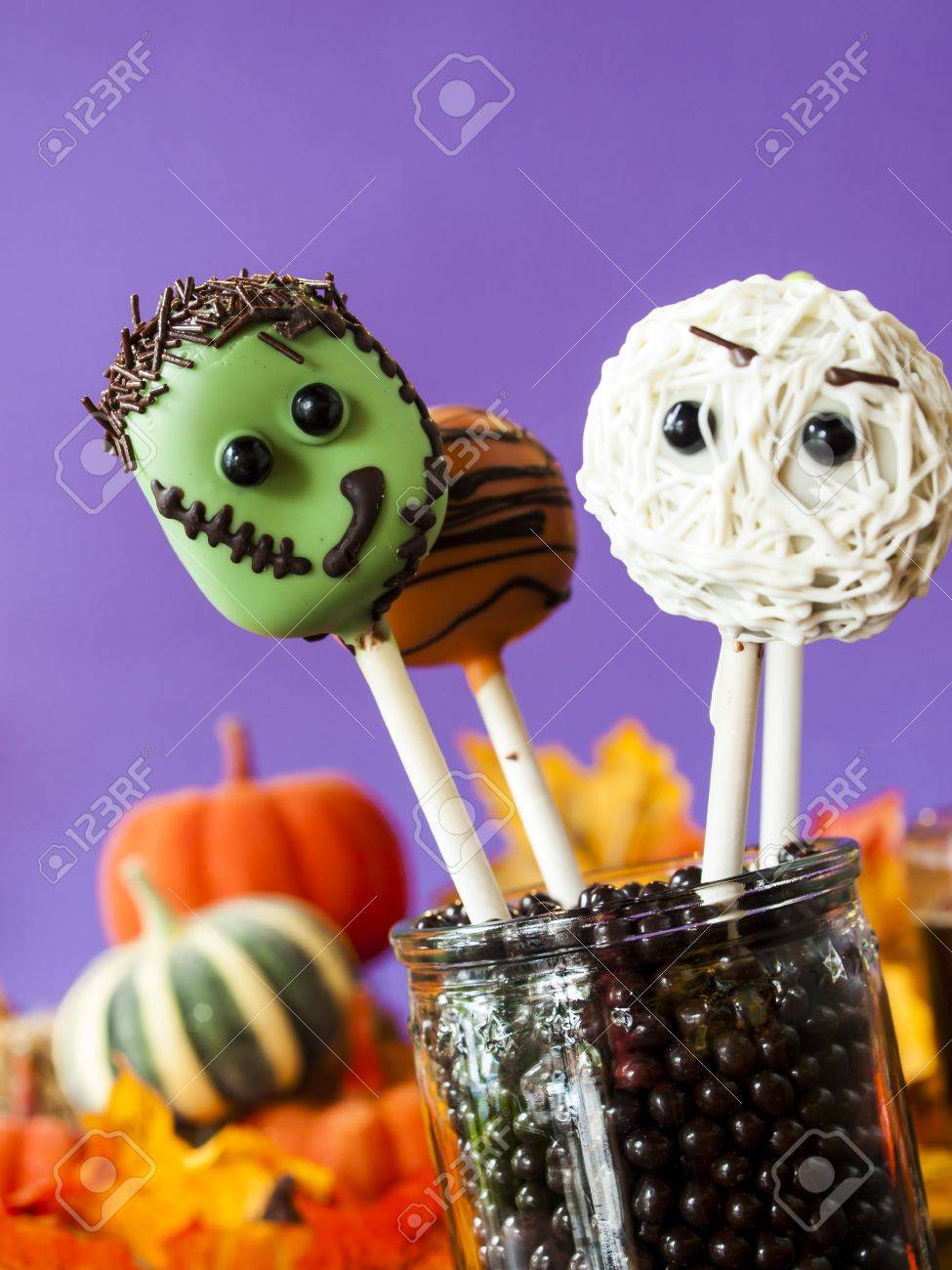 halloween gourmet cake pops with purple backround. stock photo