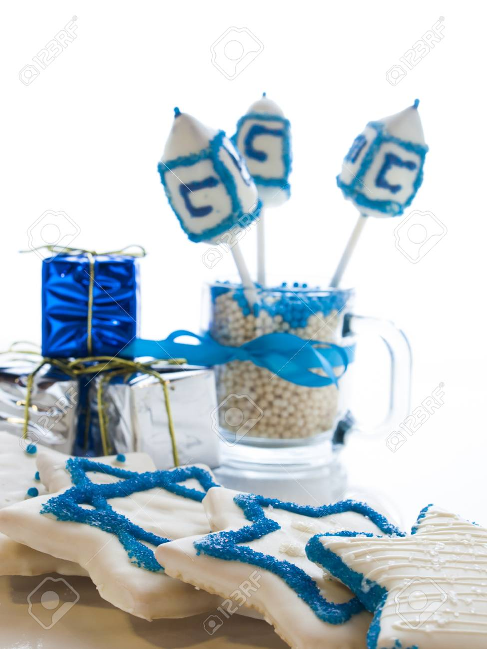 Gourmet dreidels decorated with white icing for Hanukkah. Stock Photo - 15943890
