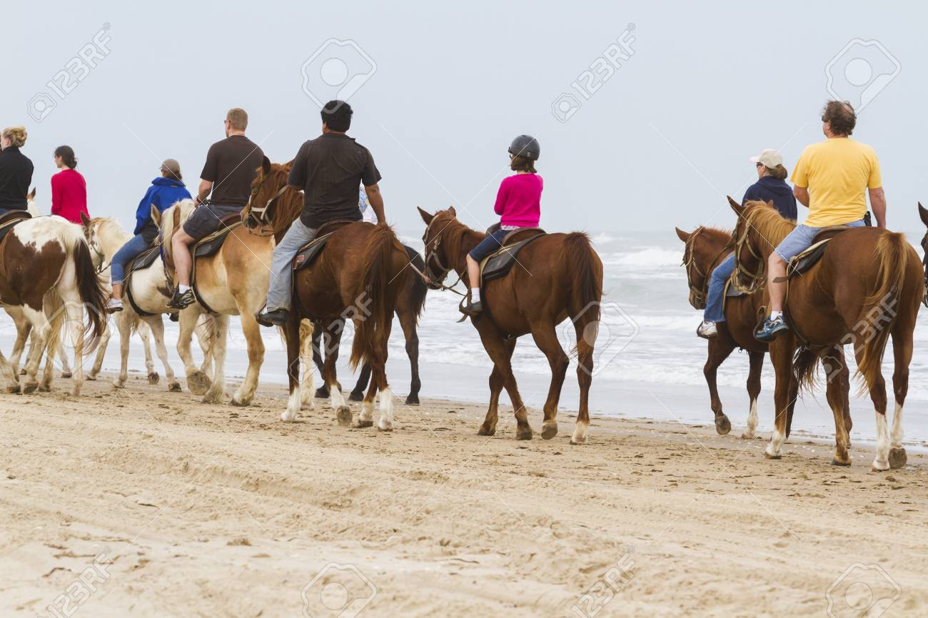 Horeseback riding on the beach of South Padre Island, TX. Stock Photo - 17175327