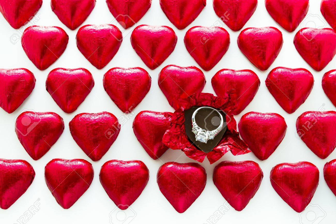 heart shape chocolate candies wrapped in red foil for valentine u0027s