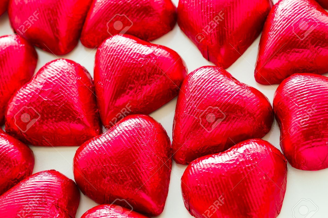 Heart Shape Chocolate Candies Wrapped In Red Foil For Valentine\'s ...
