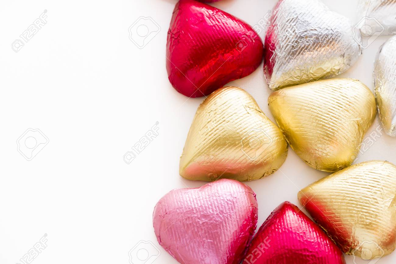 Heart shape chocolate candies wrapped in colorful foil for Valentine's Day. Stock Photo - 17406587