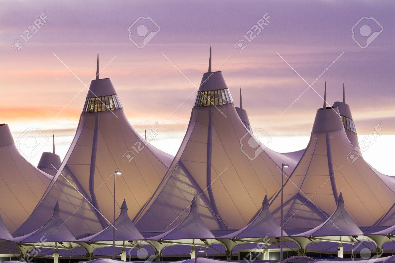 Glowing Tents Of DIA At Sunrise. Denver International Airport Well Known  For Peaked Roof.