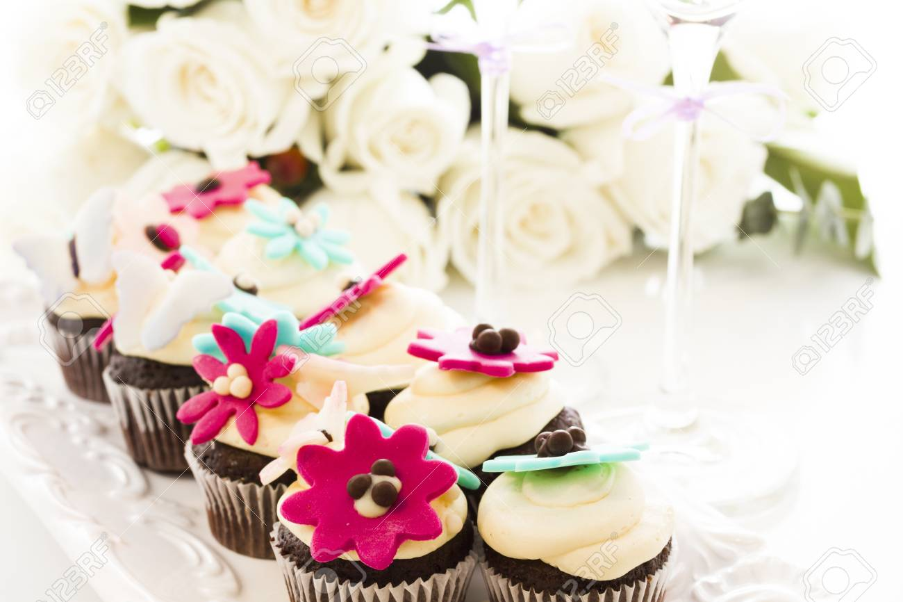 Miniature Cupcakes Decorated With Bright Flowers For The Wedding ...