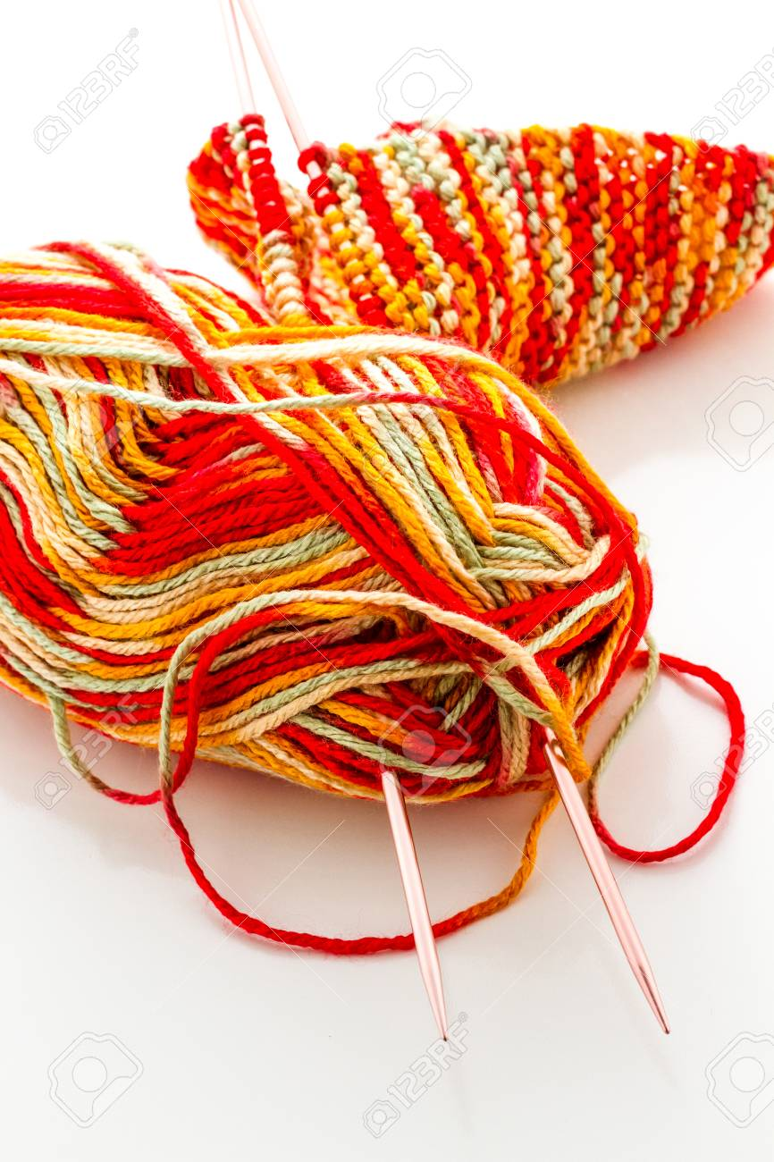 Knitting with multi colored yarn with orange, red, and yellow tones. Stock Photo - 22856294