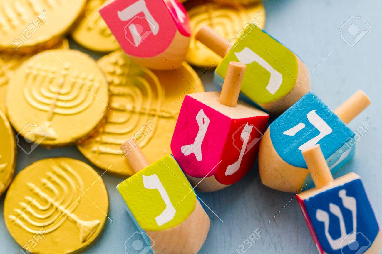 A still life composed of elements of the Jewish Chanukah/Hanukkah festival. Stock Photo - 23963988