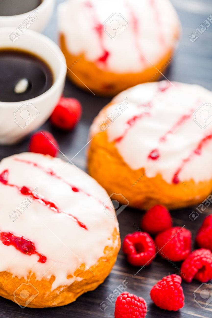 Fresh raspberry jelly filled donuts with white glazing on top. Stock Photo - 25843991
