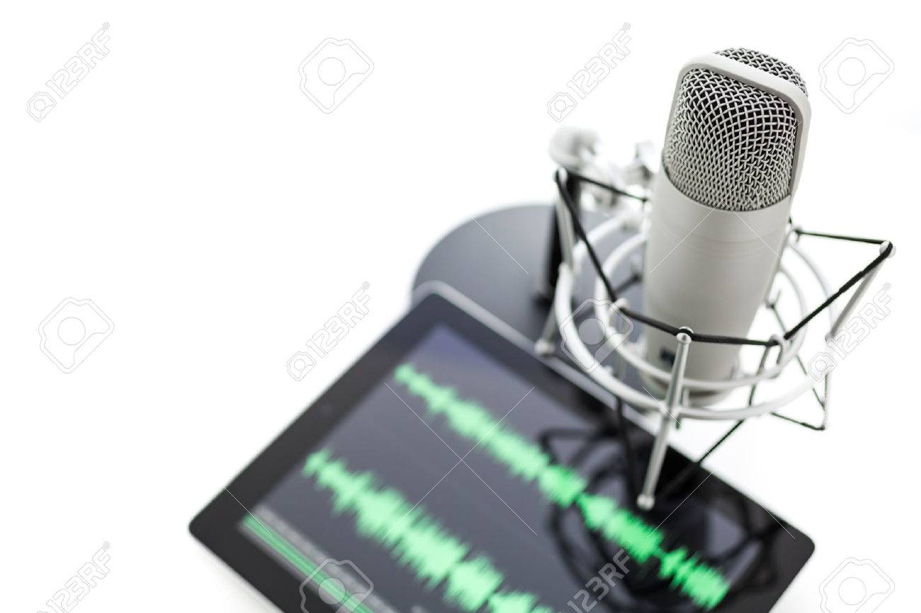 Studio microphone for recording podcasts and computer tablet on a white background. Stock Photo - 26956639