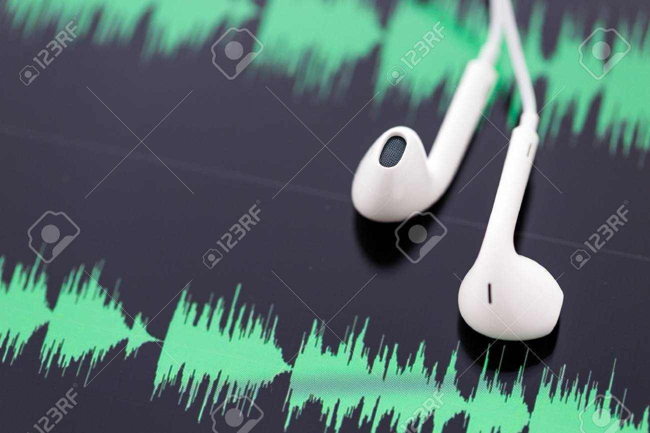white headphones on top of computer tablet. Stock Photo - 26956851