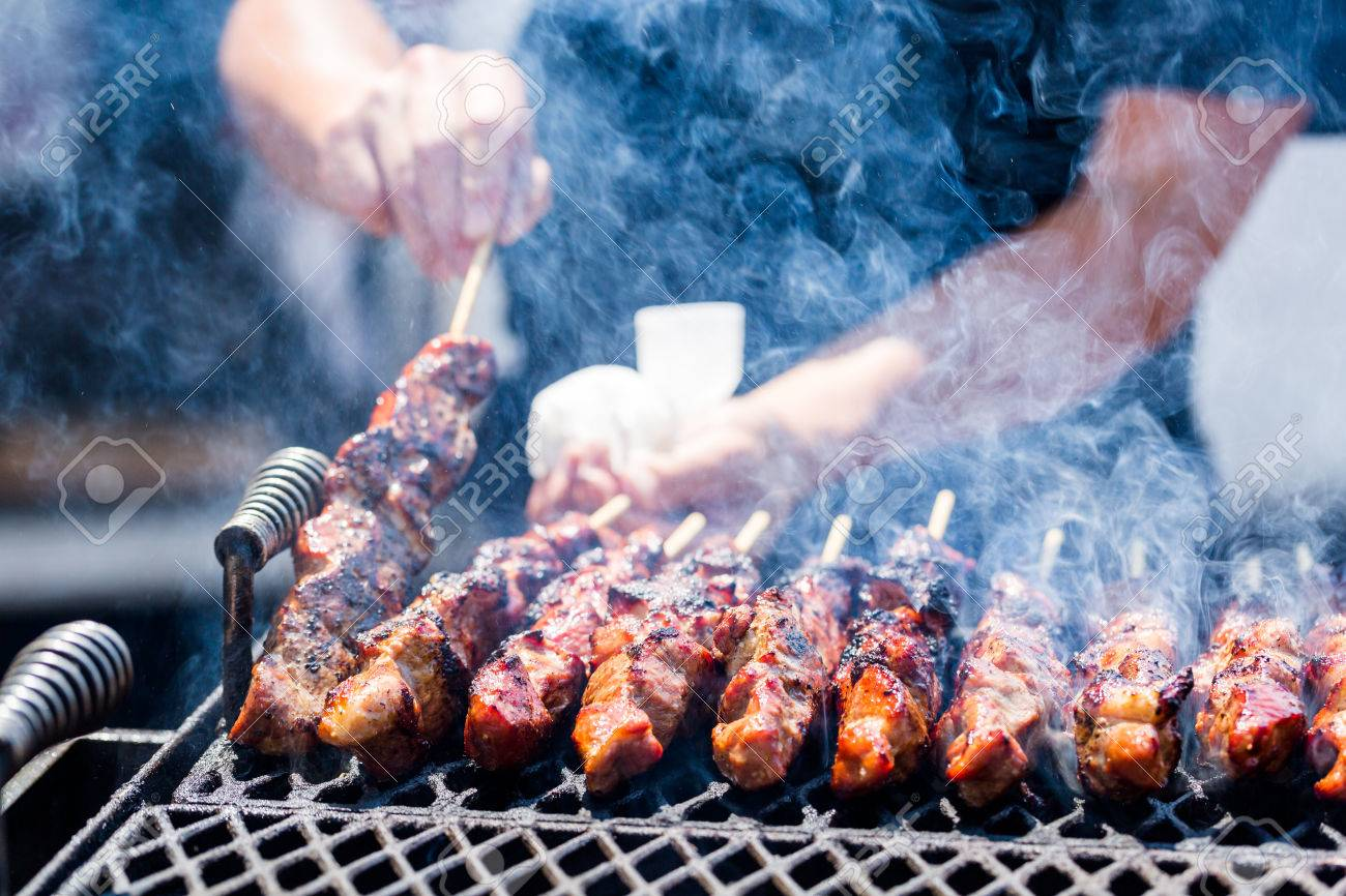 Pork on skewers cooked on barbecue grill. Stock Photo - 31179990