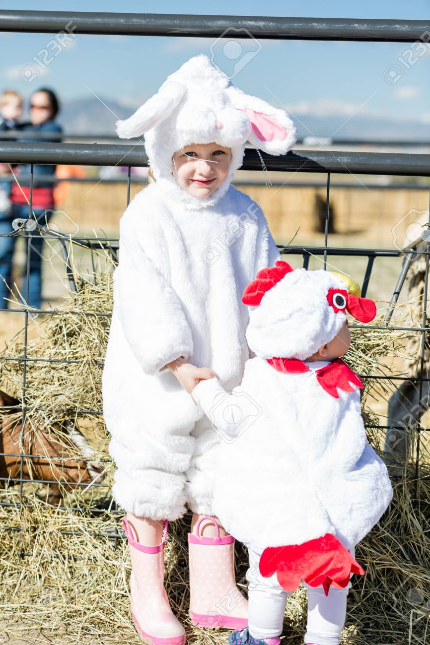 cute kids in halloween costumes at the petting zoo stock photo 32943614