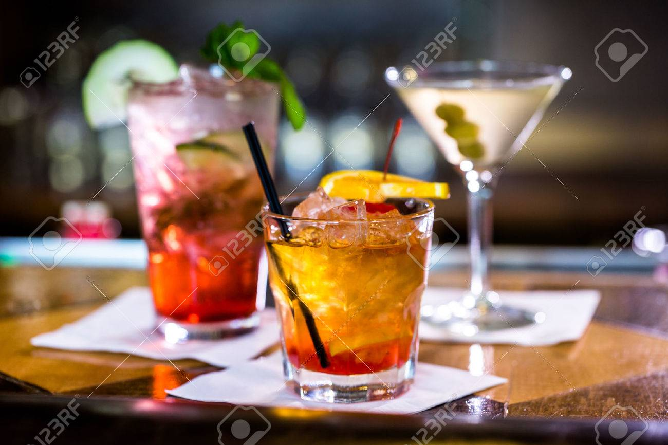 Colorful cocktails on the bar table in restaurant. Stock Photo - 39932117