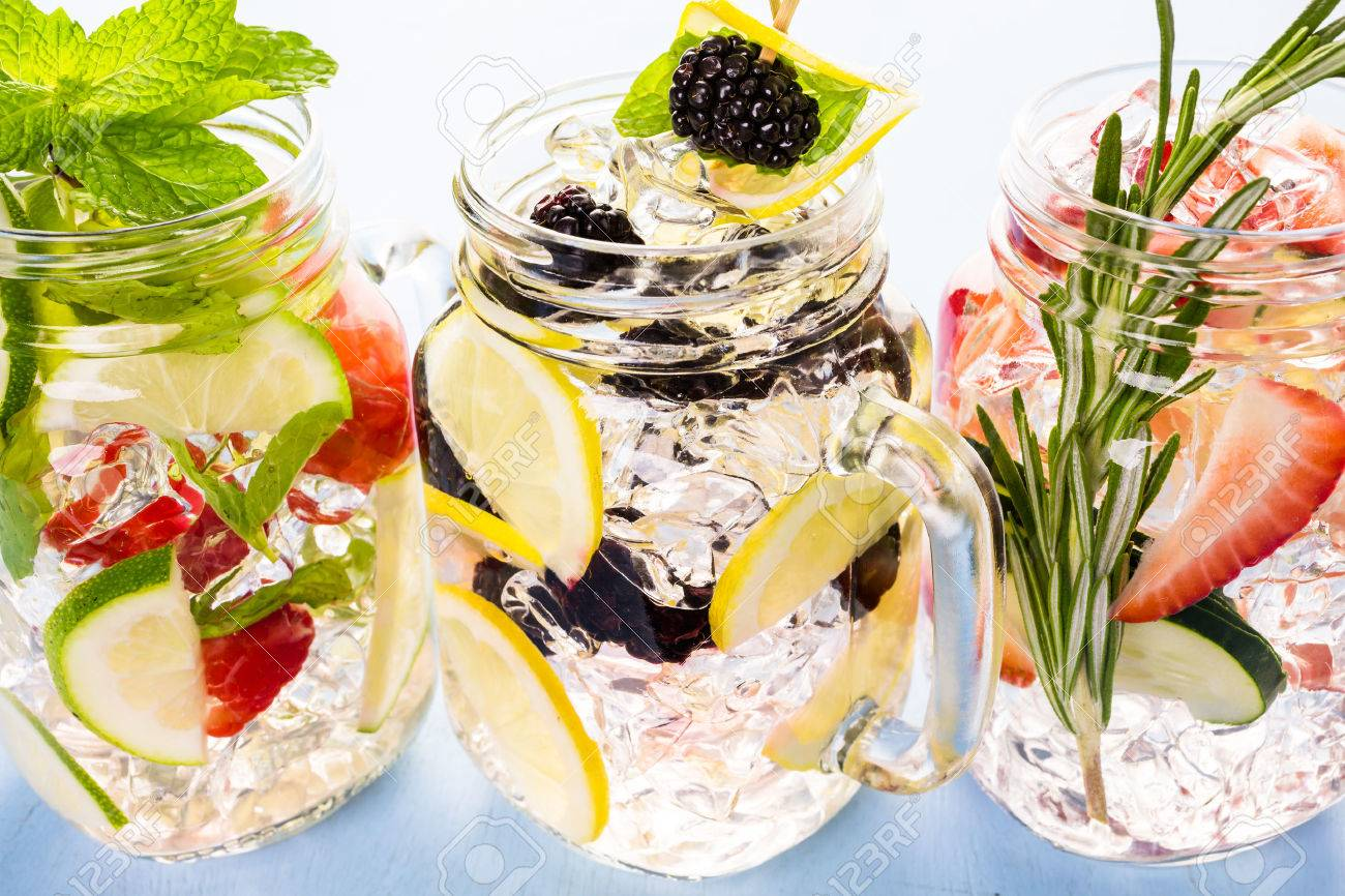 Fresh infused water made with organic ccitruses and berries. Stock Photo - 40140580