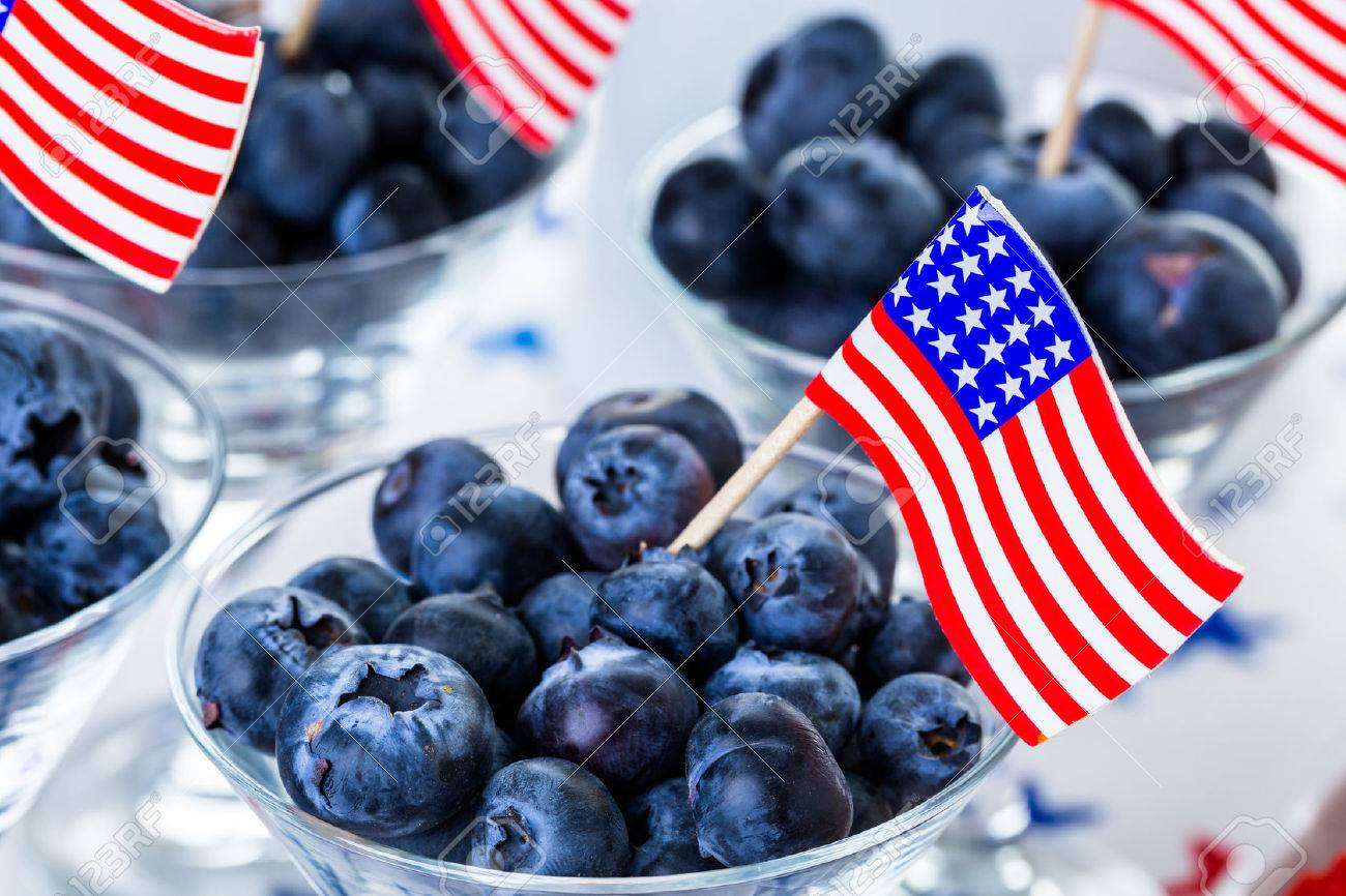 Variety of desserts on the table for July 4th party. - 40616987