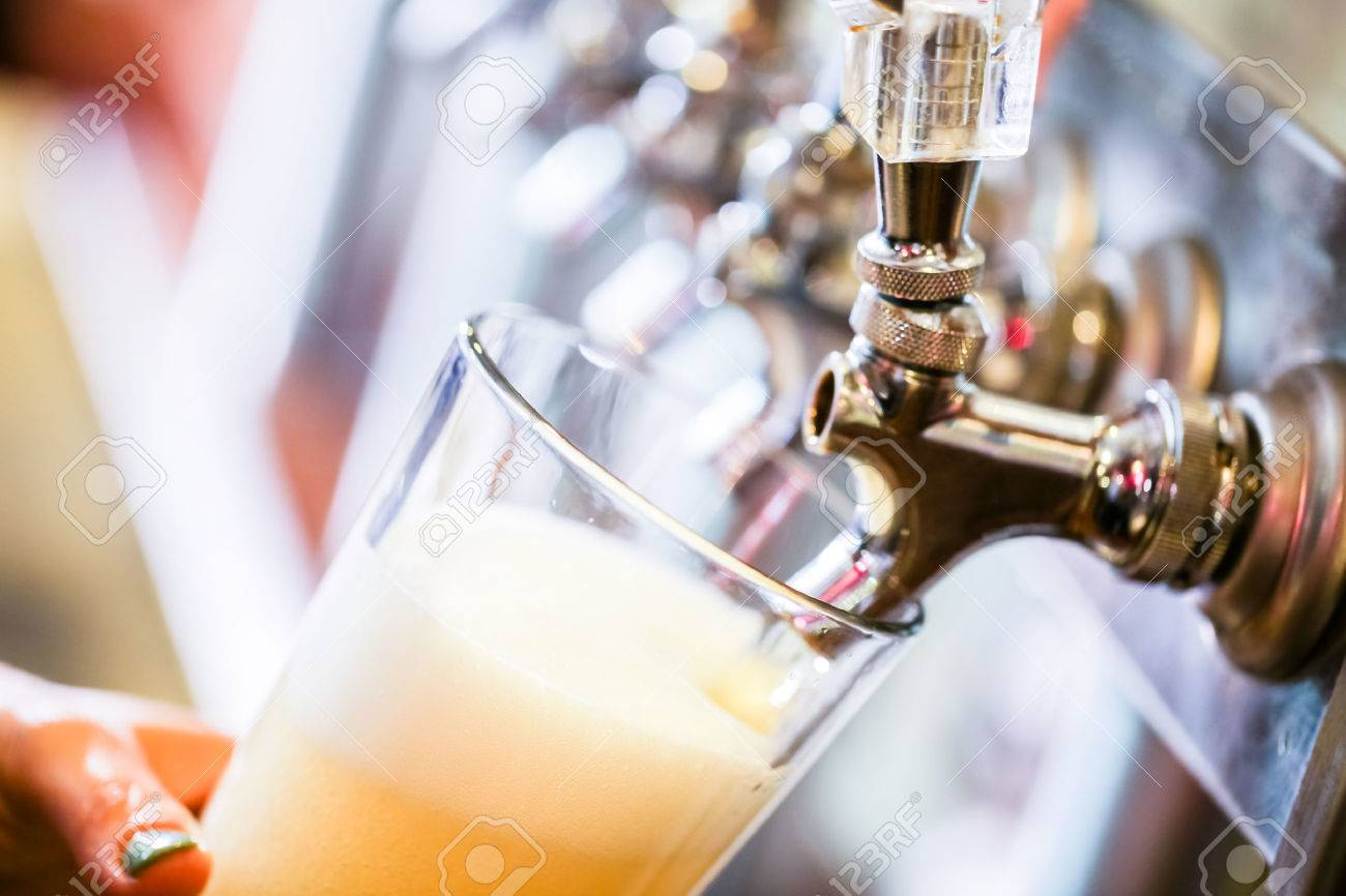 Bartender pouring draft beer in the bar. Stock Photo - 40792789