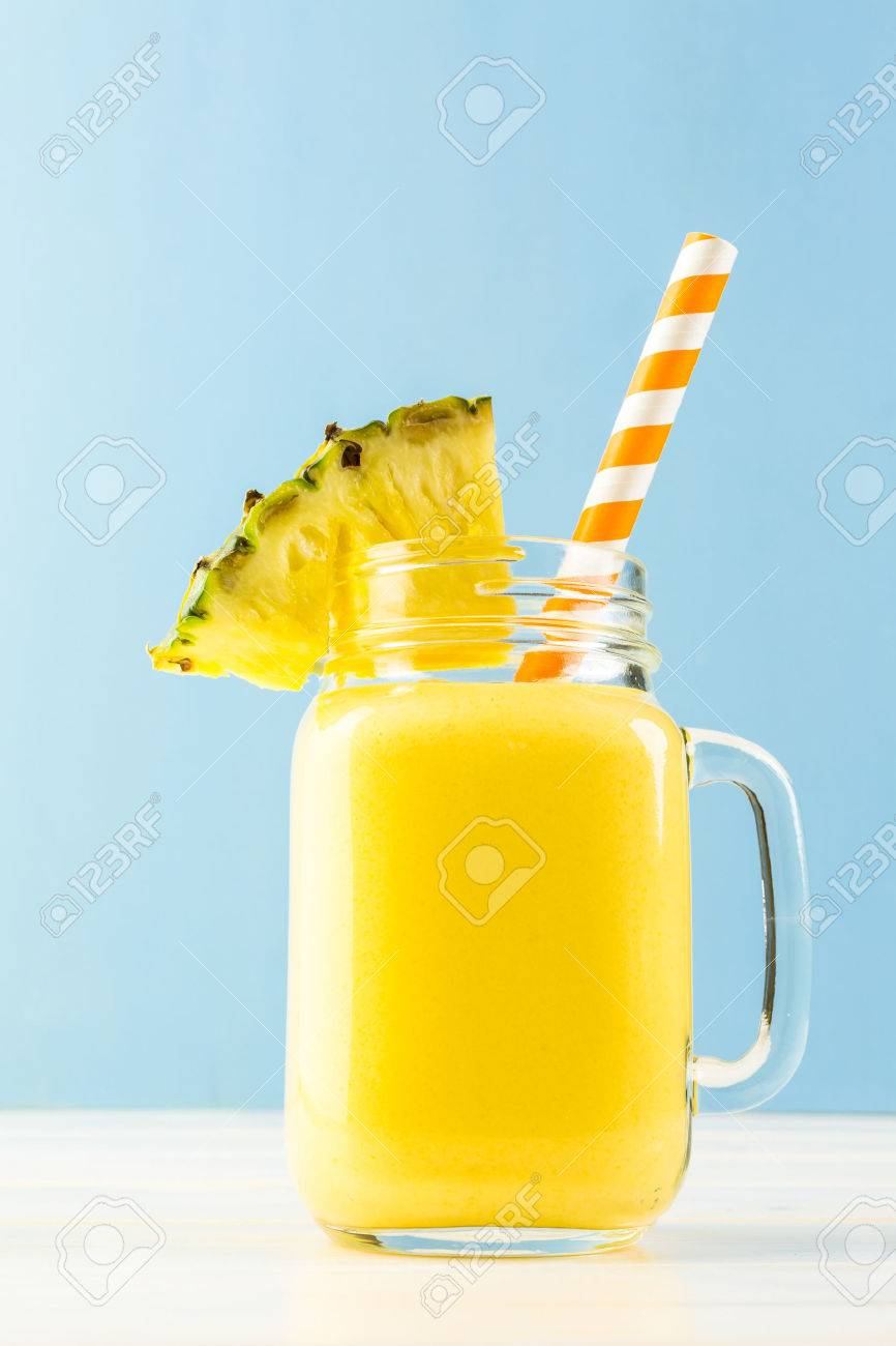 Homemade mango and pineapple smoothie made with coonut milk. - 41899149