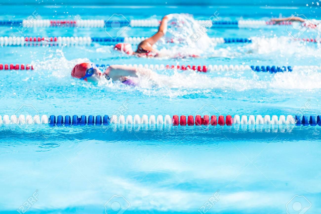Kids swim meet in outdoor pool during the summer. - 42559542