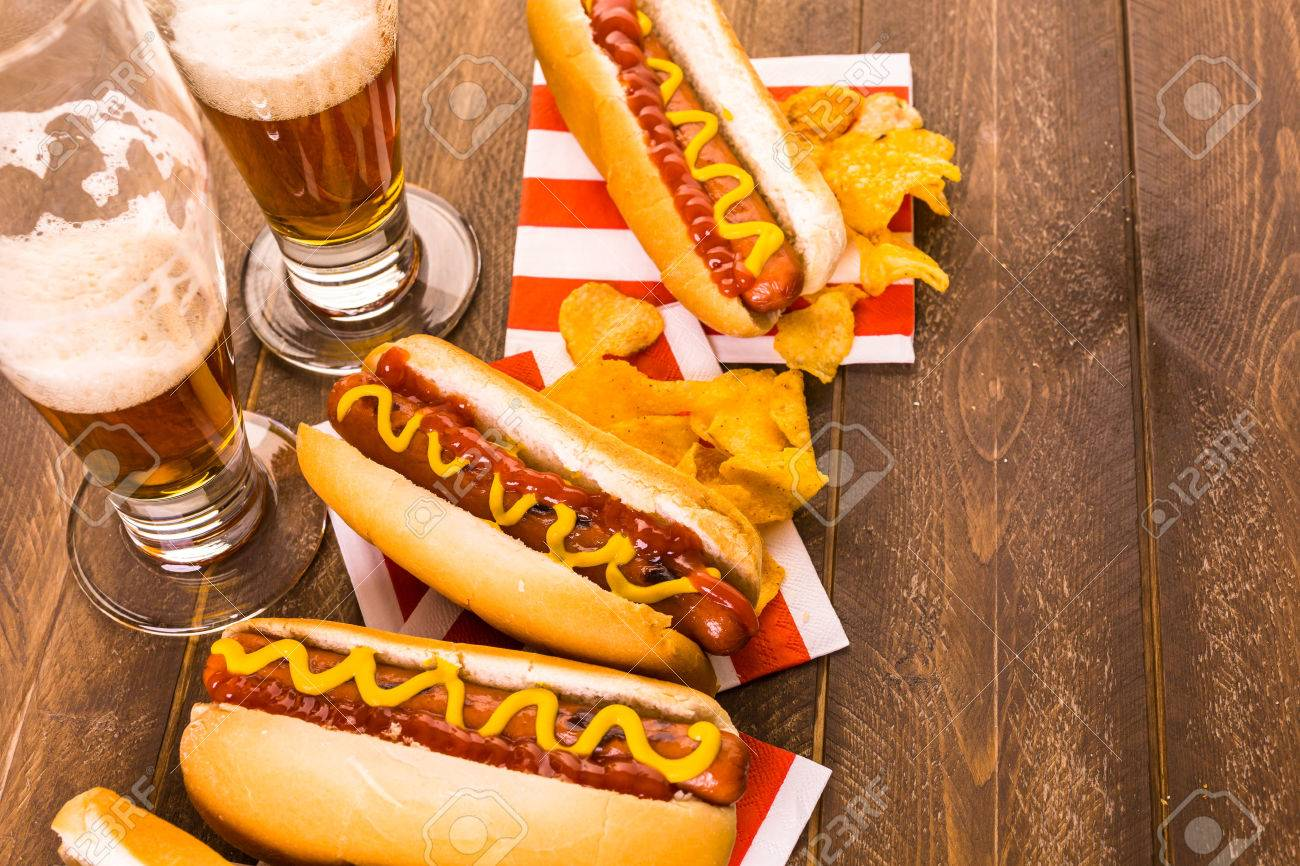 Grilled Hot Dogs With Mustard And Ketchup On The Table With Draft ...