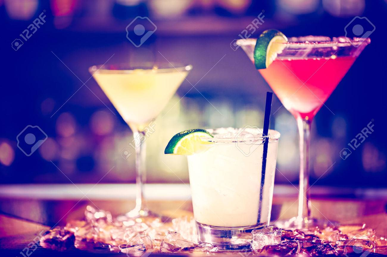 Variety of cocktails at the bar. - 47577133
