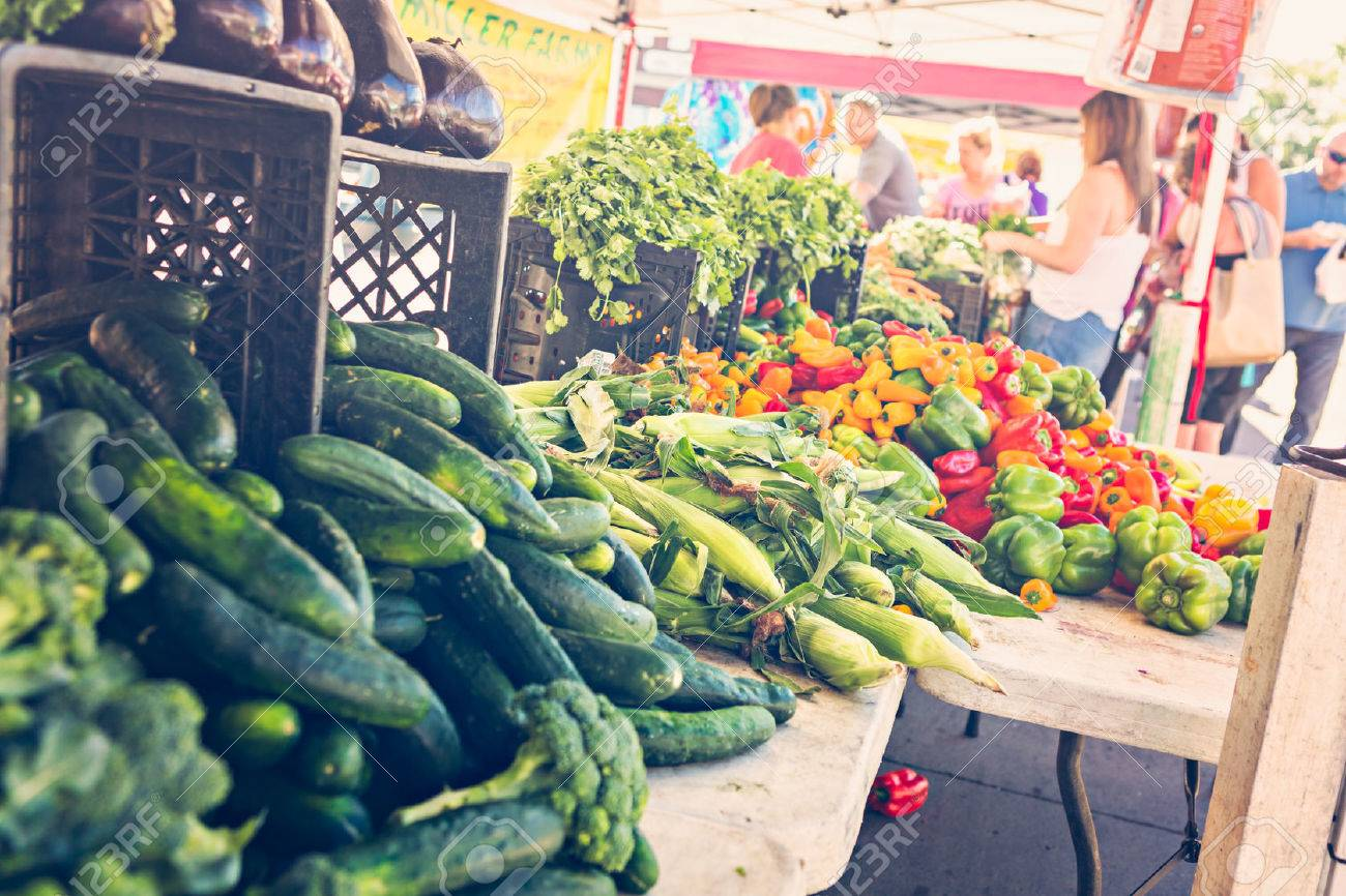 Local produce at the summer farmers market in the city. Stock Photo - 47939388