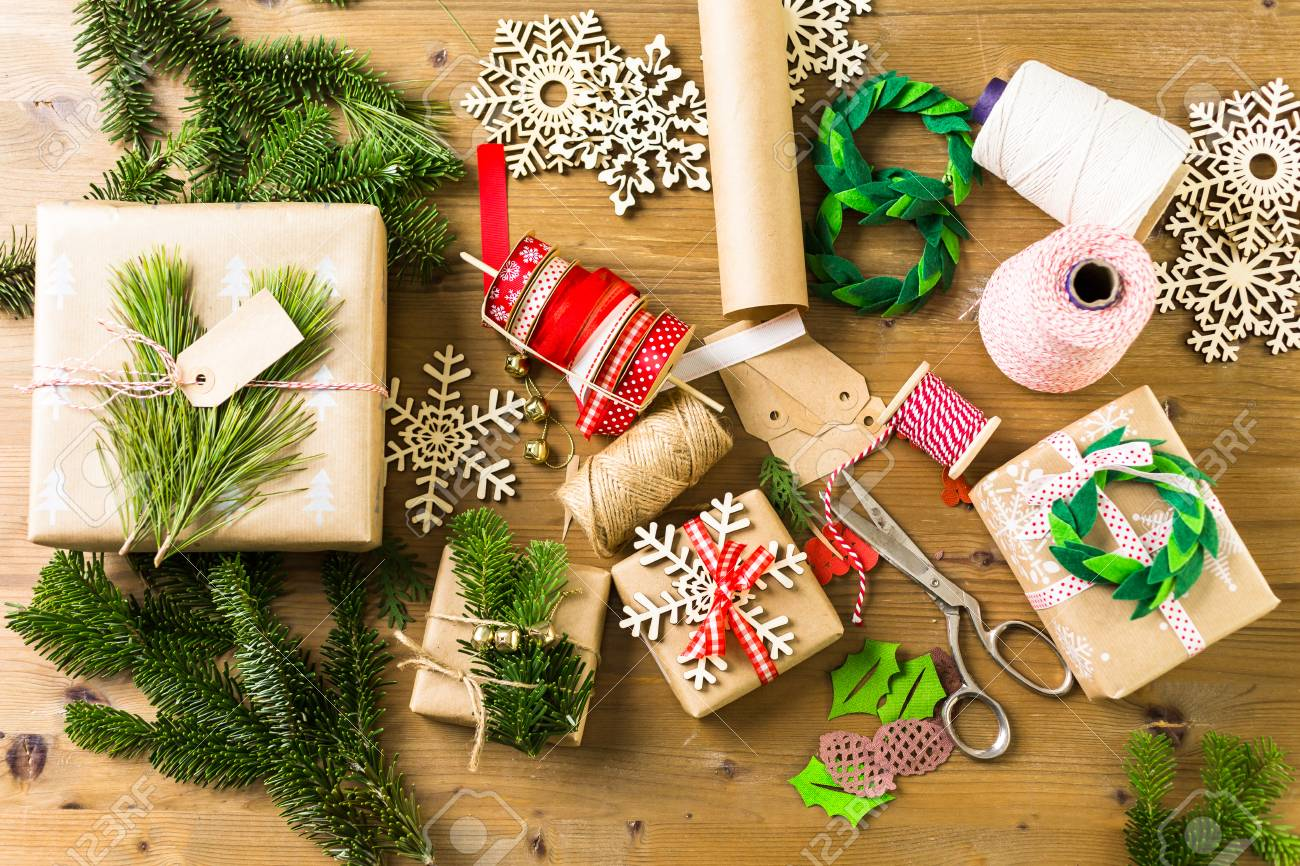 Stock Photo - Wrapping Christmas gifts in recycled brown paper with vintage style at home. & Wrapping Christmas Gifts In Recycled Brown Paper With Vintage ...