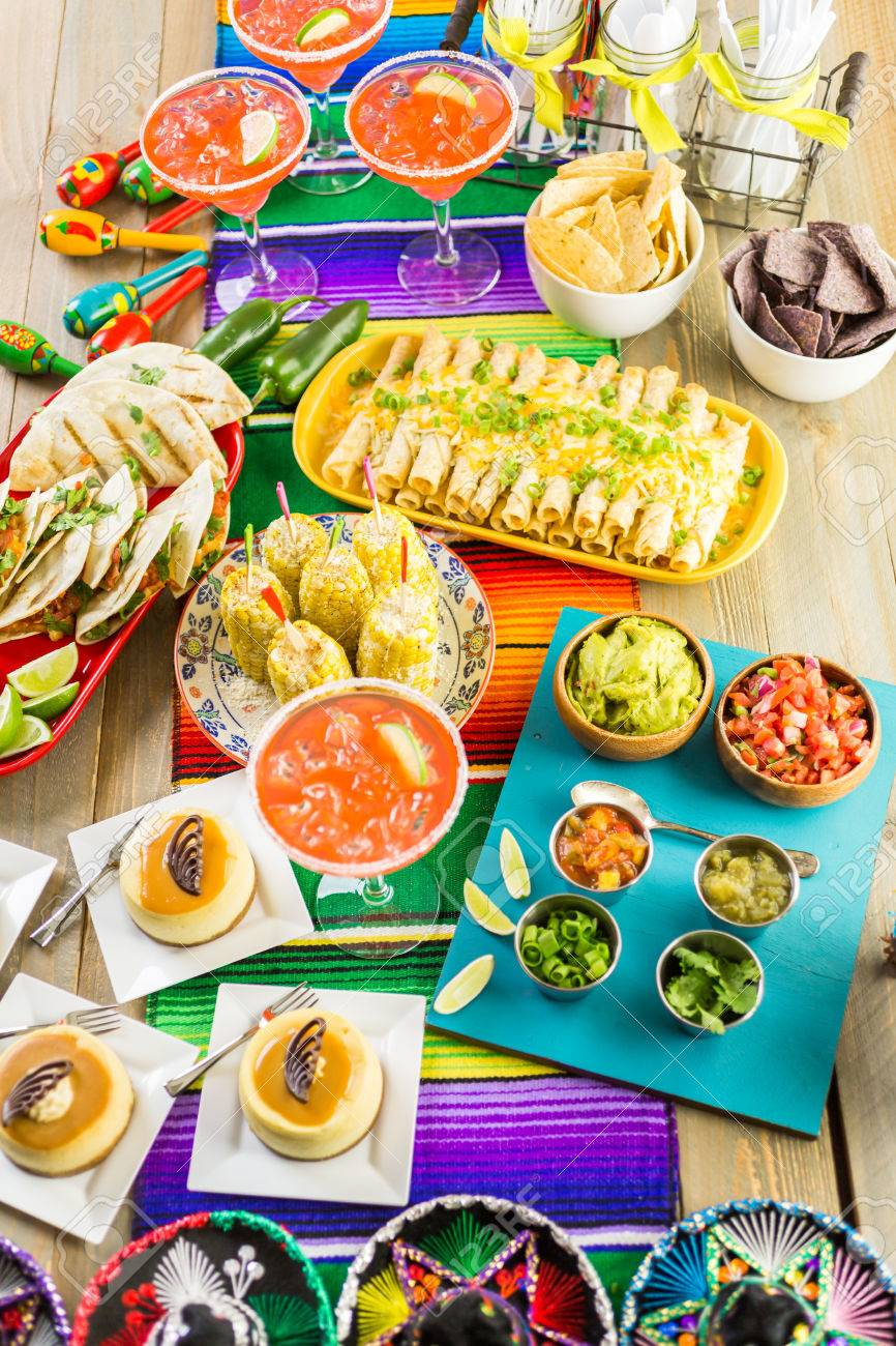 Dinner table with mexican food - Fiesta Party Buffet Table With Traditional Mexican Food Stock Photo 57198959