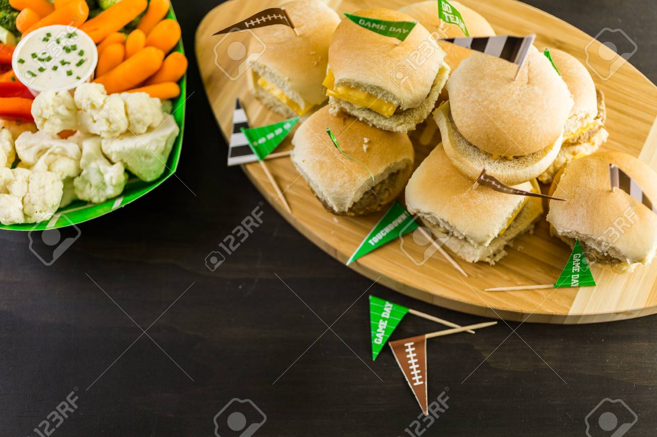 Sliders With Veggie Tray On The Table For The Football Party. Stock Photo    62646280