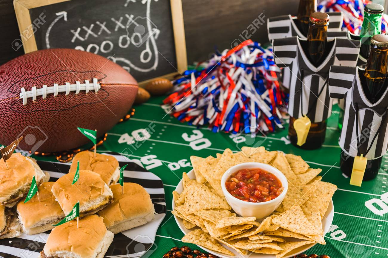 Game day football party table with beer, chips and salsa. - 68091333